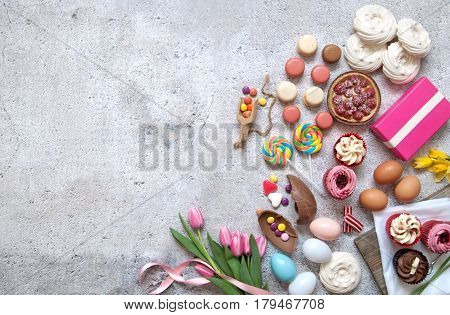 Assorted easter sweets bakery cupcakes chocolate eggs and confectionery with space