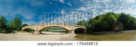 Huge panorama.Beautiful bridge above the White river in caucasian mountains in Adygea, Russia