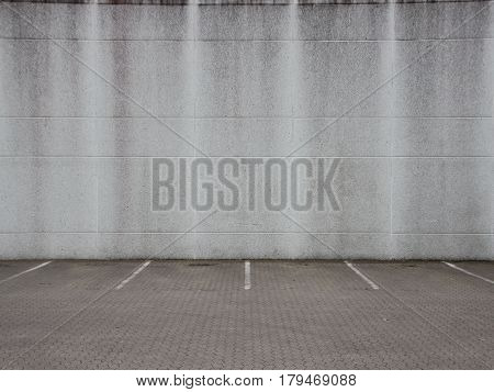 Empty Grey Urban Ghetto Parking Lot with Concrete Wall