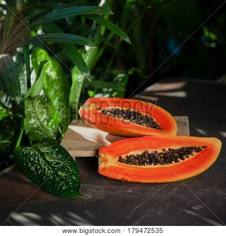 Fresh Ripe Tropical Fruit: Orange Papaya On Green Nature Background