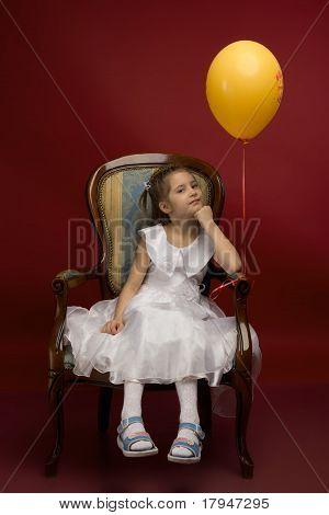little girl with yellow balloon