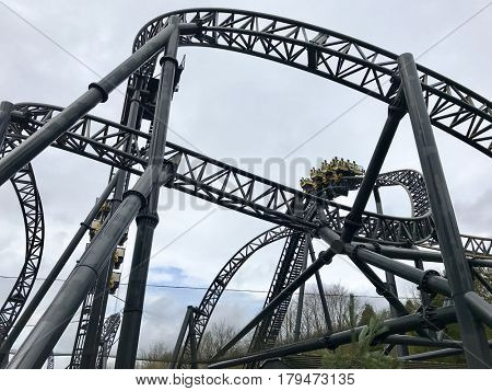 ALTON TOWERS - MARCH 30, 2017: The Smiler steel roller coaster at Alton Towers Resort in Staffordshire, England, UK. The ride features 14 inversions.
