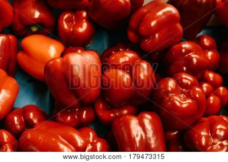 Red pepper background. Fresh and organic vegetables at farmers market. Marketplace. Natural produce.