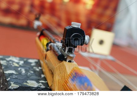 Sport rifle prepared to shoot in competition on the table in a special shooting range. The competition on sports shooting a rifle with a sight. Soft focus.