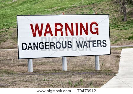 A big sign near a hydroelectric dam in Tennessee warns boaters swimmers and others of the dangerous waters below.