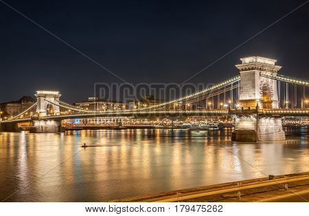 BUDAPEST HUNGARY - FEBRUARY 20 2016: Night view of the Szechenyi Chain Bridge in Budapest the capital of Hungary.