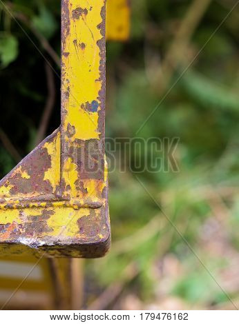 Old Rusting Metal Skip Container With Yellow Pealing Paint