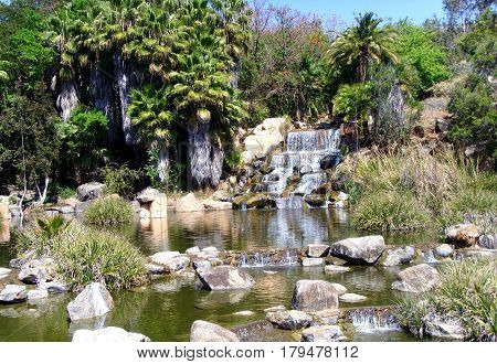 Beautiful view of the garden and small waterfall with small river