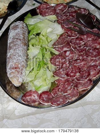 plate of hors d'oeuvres of Italian salami