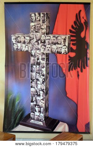 TIRANA, ALBANIA - SEPTEMBER 27: Cross with images murdered priests during the communist regime in Albania, St Paul's Cathedral in Tirana, Albania on September 27, 2016.