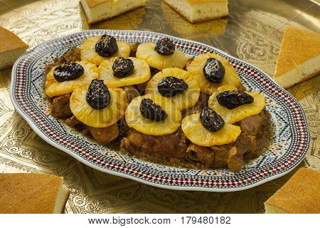 Moroccan dish with meat, pineapple,prunes and bread