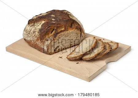 Traditional fresh german Krustenbrot and slices on a cuttingboard on white background