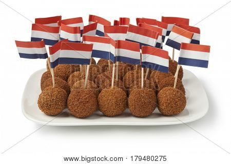 Dish with Dutch traditional snack bitterballen and dutch flag cocktail stick on white background