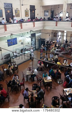 KOLKATA, INDIA - FEBRUARY 11: Visitors of popular Indian Coffee House have lunch in Kolkata on February 11, 2016.The India Coffee House chain was started by the Coffee Cess Committee in 1936 in Bombay