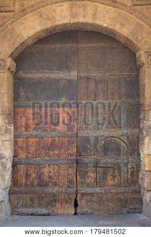 Old historical wooden gate in Cairo, Egypt