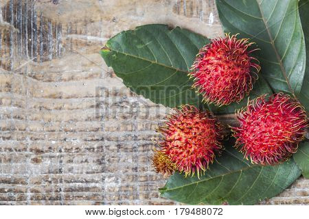 Fruits of rambutan on a wooden table