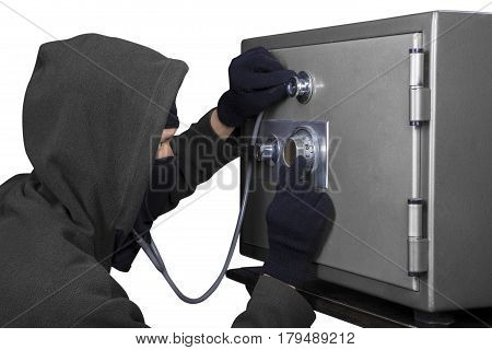 Male thief using a stethoscope to open a combination lock on the bank vault isolated on white background