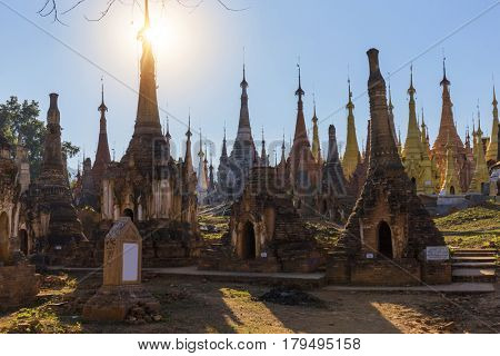 Ruins of ancient Burmese Buddhist pagodas Nyaung Ohak in the village of Indein on Inlay Lake in Shan State, Myanmar, Burma)