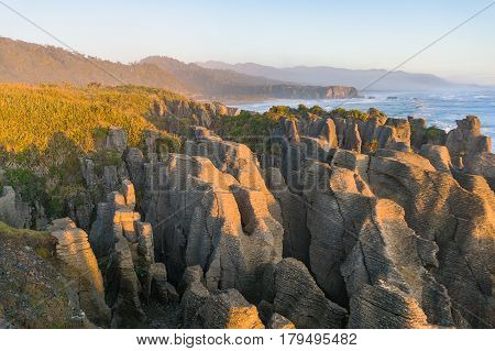 Sunlit Cliffs, Rocks And Ocean Coastline Landscape