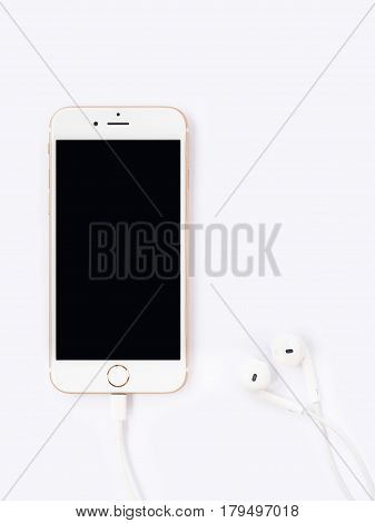 CHINGRAI THAILAND -SEPTEMBER 9 2016: Front view image of new Apple iPhone7 mockup and new Apple EarPods mockup arrangement look like a heart on white background.