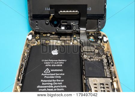 Chiangrai Thailand: March 14 2017 - Apple iPhone disassembled for repair and showing components inside. Selective focus