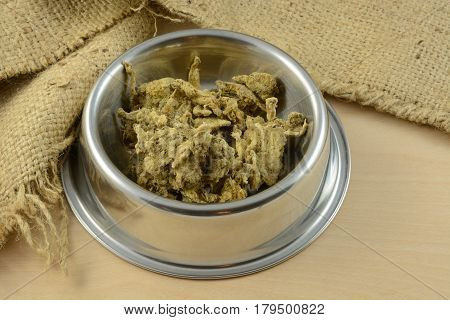Dried rushed beef tripe dog or cat food and treat for dogs and cats in stainless steel pet bowl