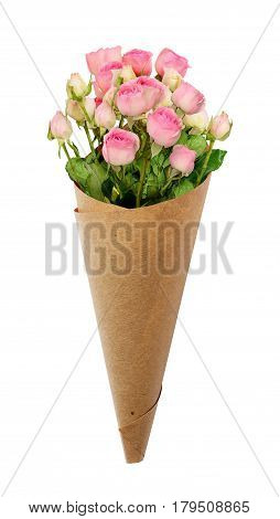 Small pink rose flowers in a paper cornet isolated on white