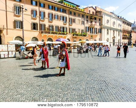 Rome, Italy - September 10, 2015: Tourists walking at Piazza Navona on September 10, 2015 in Rome, Italy. Piazza Navona is a popular destination in Rome, the 3rd most visited city in European Union.