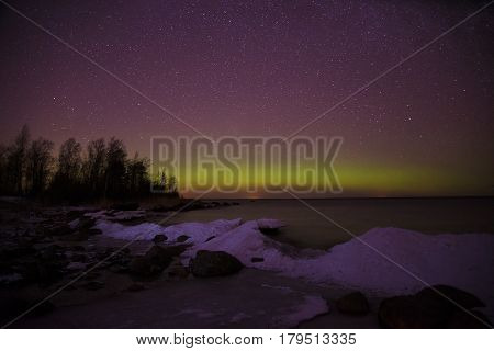 Shore of Ladoga lake and Aurora borealis. Pyatirechye, Leningrad region. Russia