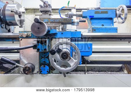 Lathe machine in a workshop. Part of the lathe. Lathe machine is operation on the work shop.
