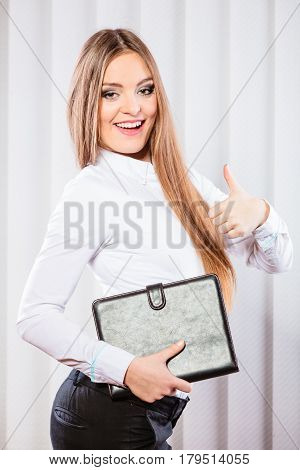 Career business work in office. Young woman in formal wear hold case with files documents paperwork with thumb up.