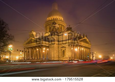SAINT PETERSBURG, RUSSIA - MARCH 12, 2017: St. Isaac's Cathedral in the urban landscape of the misty night. March in Saint Petersburg