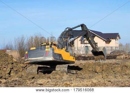 LENINGRAD REGION, RUSSIA - MARCH 09, 2017: Crawler excavator digs a trench