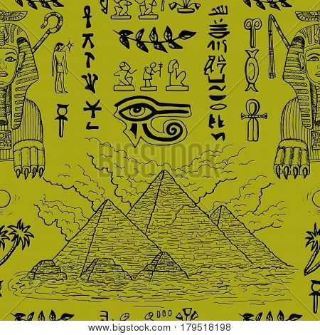 Seamless background with Sphinx, pyramids and traditional Egyptian symbols. May be used as wrapping paper, textile design