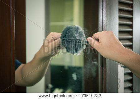 forensic hand searching latent fingerprint of murderer by brush technic in cinematic tone