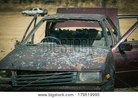 wrecked vehicle in car bomb demonstration in forensic and law enforcement training course