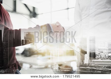business, people, gesture, cooperation and partnership concept - businessmen making handshake at office over urban double exposure effect