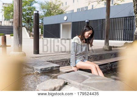 Woman enjoy foot onsen in japan