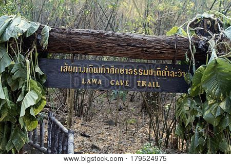 Lawa cave trail rustic signboard  wooden outdoors