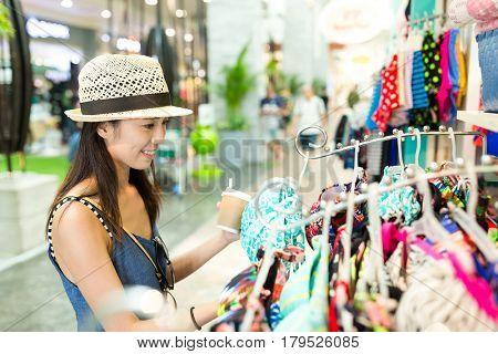 Woman choosing the swim suit in shopping mall