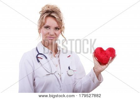 Periodic examinations. Cardiology concept. Female cardiologist holding red heart. Middle aged doctor with stethoscope and white medical apron uniform. Isolated on white. poster