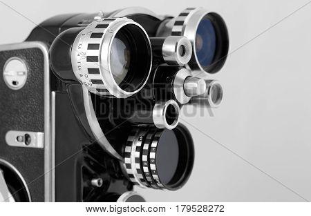cluse-up of retro camera on grey background