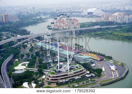 Singapore, Singapore - February 11, 2017: Singapore Flyer and Singapore river in Singapore