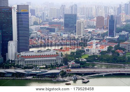 Singapore, Singapore - February 11, 2017: Downtown skyscrapers and Singapore river view in Singapore.