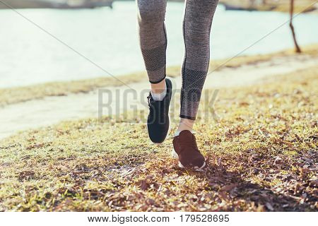 an athletic pair of legs on park - healthy lifestyle concept