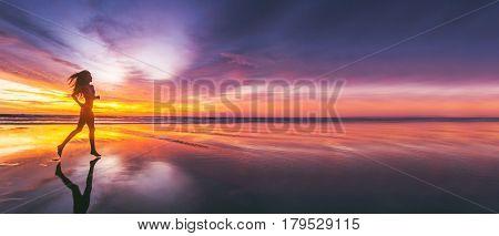 Woman running on the beach at sunset in bikini. Bali island, Indonesia