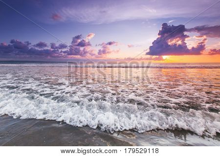 Radiant sea beach sunset, Bali island, Indonesia