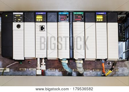 PLC programable logic controlerThis picture show hard wiring communication socket connection during technician maintenance