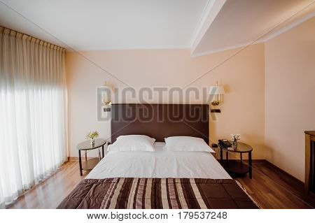 Interior of a bedroom with bed and pillow