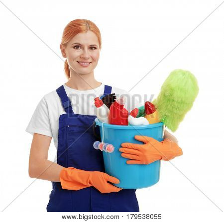 Woman holding bucket with cleaning agents and supplies on white background